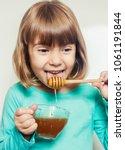 the child eats honey. selective ...   Shutterstock . vector #1061191844