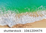emerald green sea and orange... | Shutterstock . vector #1061204474