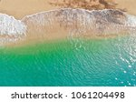 emerald green sea and orange... | Shutterstock . vector #1061204498