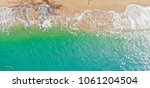 emerald green sea and orange... | Shutterstock . vector #1061204504