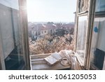 old window with the view from... | Shutterstock . vector #1061205053