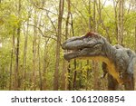 dinosaur statue in the forest... | Shutterstock . vector #1061208854