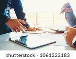 business team meeting working... | Shutterstock . vector #1061222183