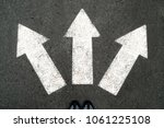 three white arrows pointing in...   Shutterstock . vector #1061225108