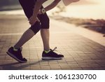 Small photo of woman runner with sports running knee injury