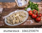 tasty pelmeni or manti on... | Shutterstock . vector #1061253074