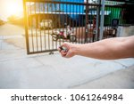 man used remote control open... | Shutterstock . vector #1061264984