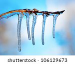 Branch With Icicles On Blue Sky ...