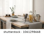 table served with plates and... | Shutterstock . vector #1061298668