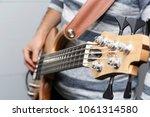 closeup photo of bass guitar... | Shutterstock . vector #1061314580