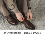 close up view of man tying... | Shutterstock . vector #1061319218