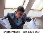 overworked  angry businessman... | Shutterstock . vector #1061321150
