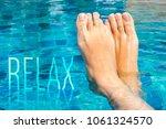 beautiful female feet relax in... | Shutterstock . vector #1061324570