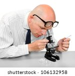 Male scientist with his microscope. - stock photo