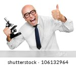 Funny scientist with microscope celebrating his new invention. - stock photo