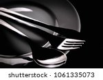 knife fork and spoon on a white ... | Shutterstock . vector #1061335073