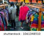 women browsing through vintage... | Shutterstock . vector #1061348510