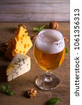 Beer And Cheese. Beer Glass On...