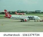 Small photo of Thailand-August 22,2017: Thai AirAsia Airbus A320 in Carabao Special Livery (Reg. HS-ABJ) Pushing Back and Thai AirAsia Airbus A320 Landing at Don Muang International Airport.