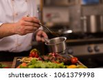 chef finishing steak meat plate ... | Shutterstock . vector #1061379998