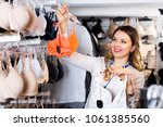 beautiful female customer... | Shutterstock . vector #1061385560