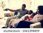 african family spending time... | Shutterstock . vector #1061398859