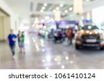 blur image of the car showroom. | Shutterstock . vector #1061410124