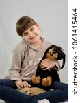 Small photo of pretty portrait of smilling caucasian girl hugging mini chihuahua dog and toy dog, closeup, isolated on white