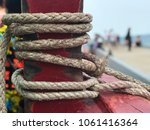 rope on a yacht with wooden... | Shutterstock . vector #1061416364