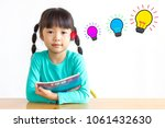 asian girl  she likes to read a ... | Shutterstock . vector #1061432630