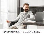 photo of positive man 30s in...   Shutterstock . vector #1061435189