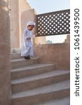 emirates kid plays in old house | Shutterstock . vector #1061439500