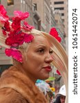 Small photo of New York City, NY, USA-April 1, 2018: Woman wearing a hat adored with butterflies, participates in the annual Easter Bonnet Parade on Fifth Avenue.