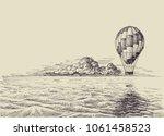 hot air balloon over the sea.... | Shutterstock .eps vector #1061458523
