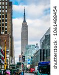 Small photo of March 10, 2018: View of street scene with Empire State Building, Manhattan, New York City in the United States