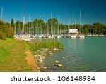 harbor with sailboats at lake... | Shutterstock . vector #106148984