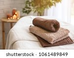 towels on massage table in spa... | Shutterstock . vector #1061489849