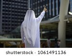 behind of the arab man point... | Shutterstock . vector #1061491136