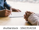 Small photo of Blur. Asian business of hand holding pen reviewing and signing,Home buying contract,Selective focus