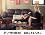 psychologist consulting a woman ... | Shutterstock . vector #1061517359