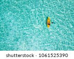 Woman In A Canoe Over Turquoise ...