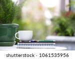 white cup and notebooks with... | Shutterstock . vector #1061535956