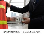 the businessman is paying it to ... | Shutterstock . vector #1061538704