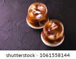 iced coffee in glasses with... | Shutterstock . vector #1061558144