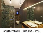 bathroom interior with a... | Shutterstock . vector #1061558198