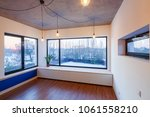 interior of an empty room with... | Shutterstock . vector #1061558210