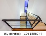 staircase in a private house... | Shutterstock . vector #1061558744