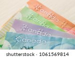 colourful canadian dollar... | Shutterstock . vector #1061569814