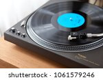 vintage record turntable plays... | Shutterstock . vector #1061579246