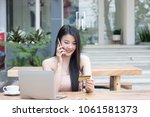 young woman holding credit card ... | Shutterstock . vector #1061581373